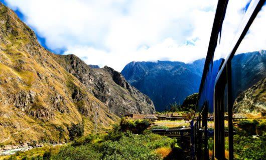 Train runs through South America mountain valley