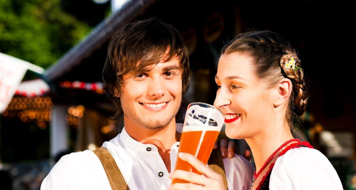 Two people enjoy a beer at Oktoberfest