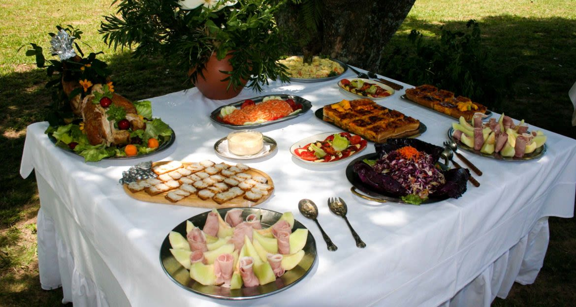 Food dishes arranged on outdoor table