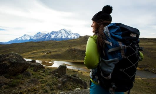 Hiker with large backpack pauses on Patagonia trail