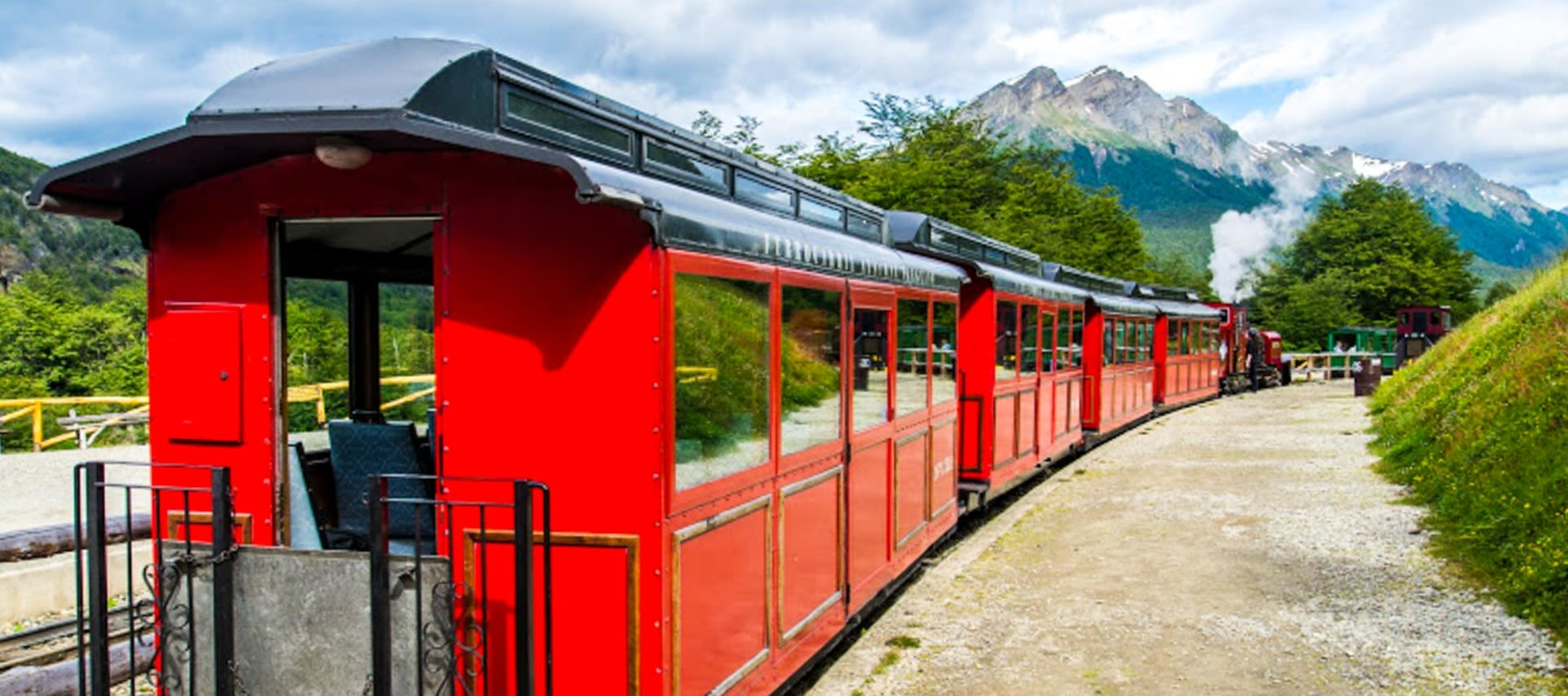 Red train near Patagonia mountains