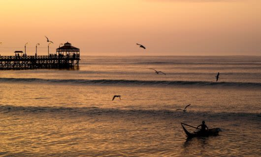 fisherman boating during sunset