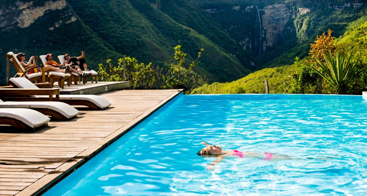 Woman floats on her back in resort pool