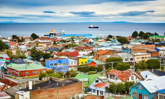 Colorful houses on coast of Punta Arenas, Chile