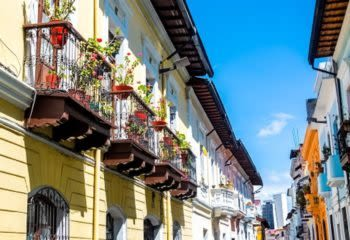 Balconies hanging over the streets of Quito Ecuador decorated by flowers