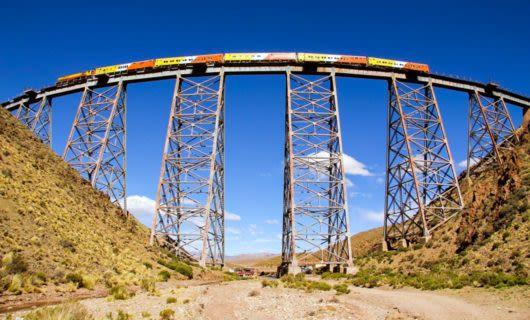 Orange and yellow bridge crosses high bridge