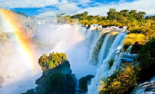 Rainbow in front of South America waterfall