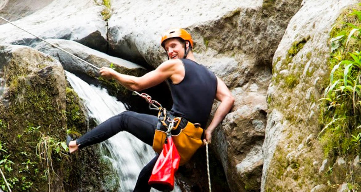 Traveler rappels down waterfall