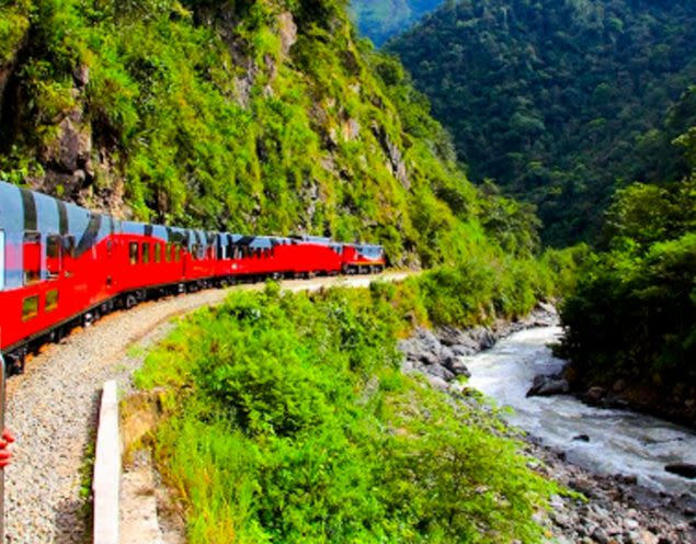 Red train runs through Andes valley