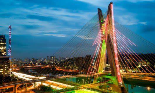Large bridge in Sao Paolo illuminated by colored lights