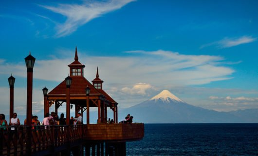 scenic boardwalk in Puerto Montt with stunning view of Osorno Volcano