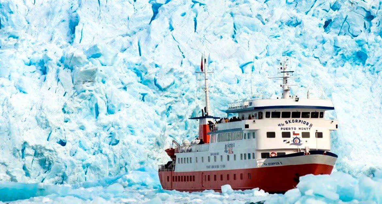 Skorpios cruise ship passes large glacier
