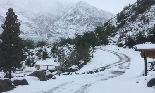 Small road winds through snowy mountains
