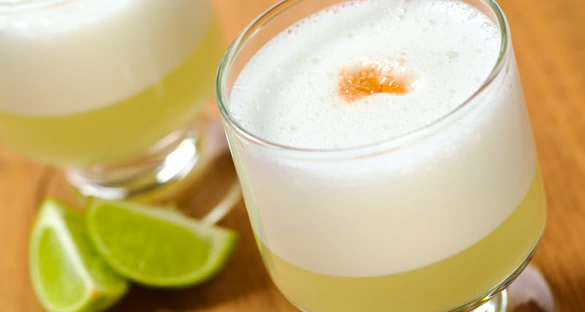 Close up of sour drink with slices of lime