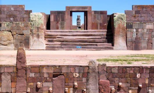Statue stands in doorway of ruins