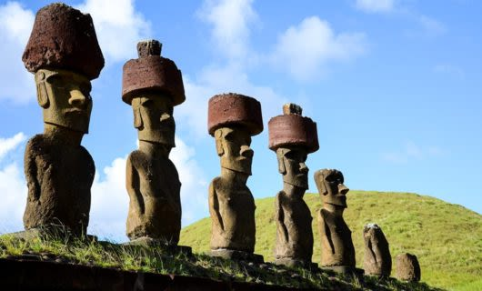 Large statues in a row on a hill