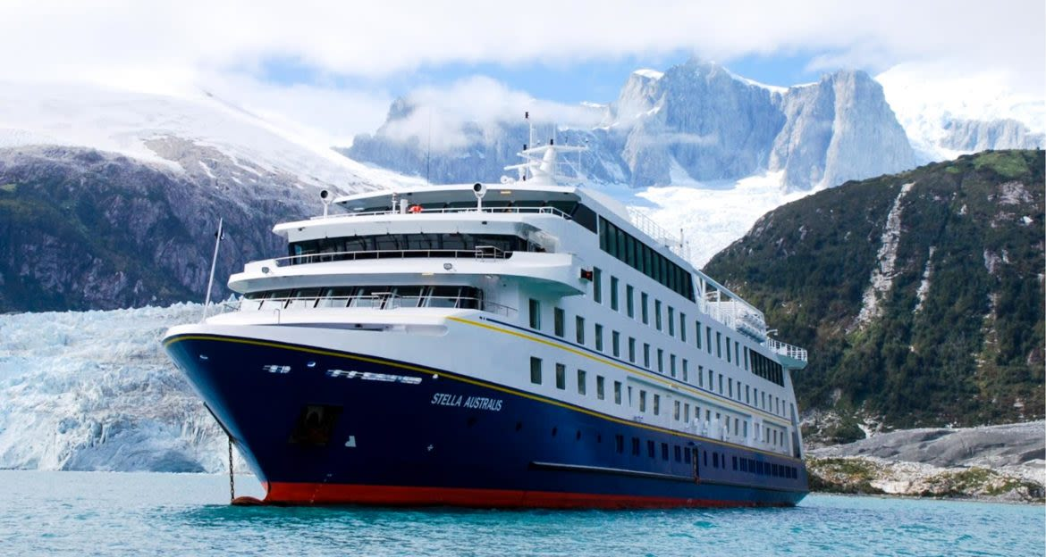 Stella Australis cruise ship in front of mountains