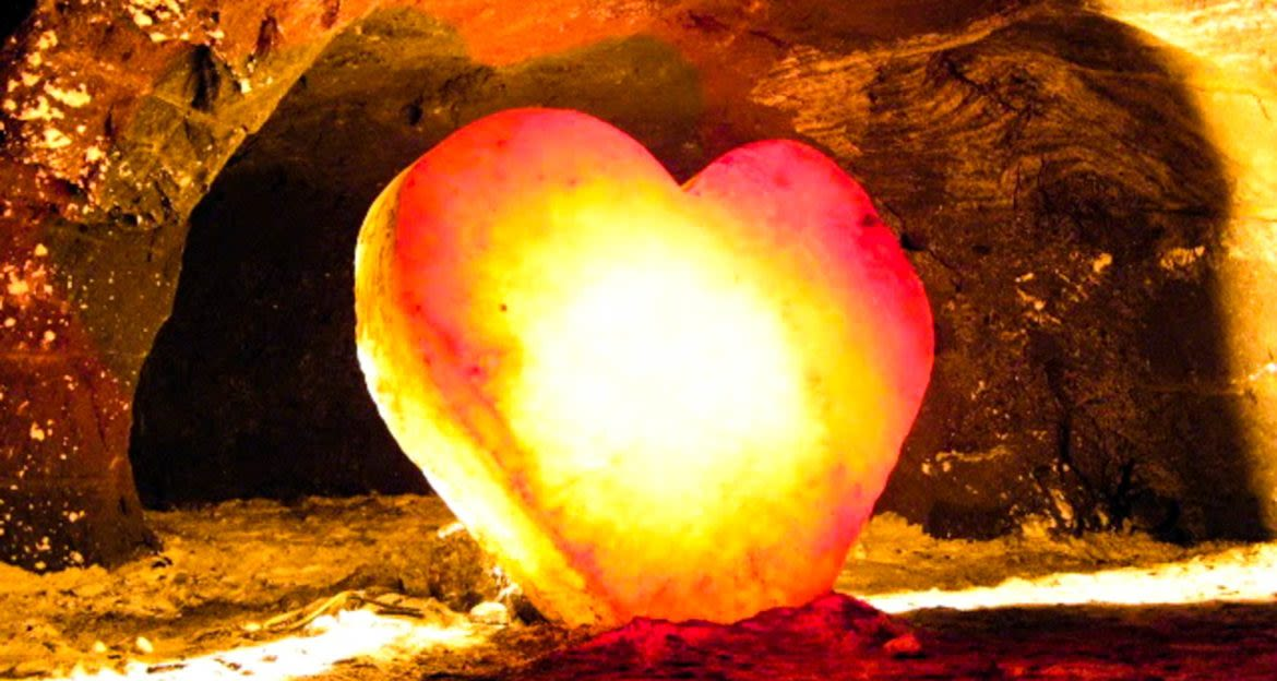 Glowing stone heart in cave