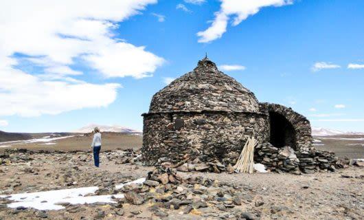 Stone hut on rocky South America landscape