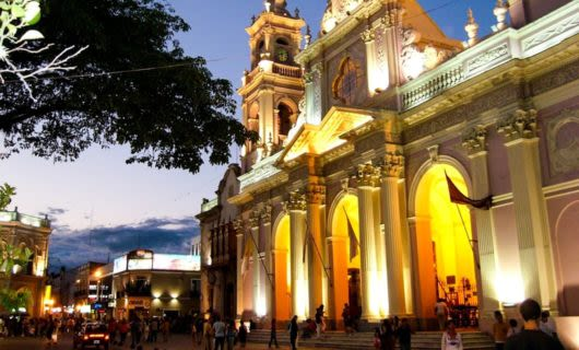 Palace in Salta on busy street at evening