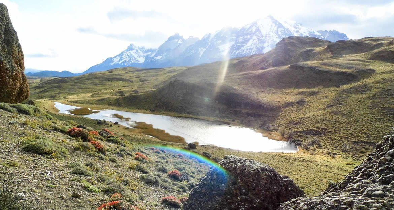 Sunlit valley between mountains