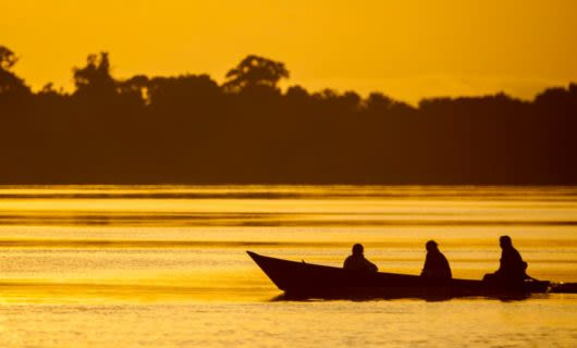 Canoe on jungle river at sunset