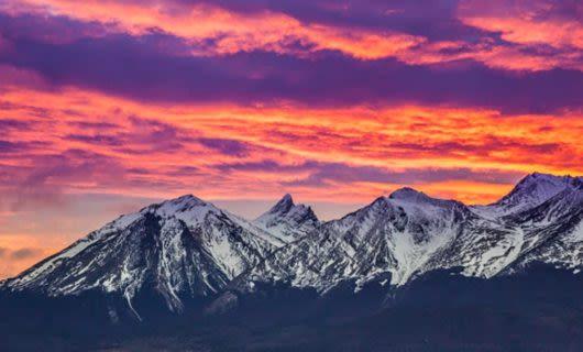 Sunset over snowy mountain range