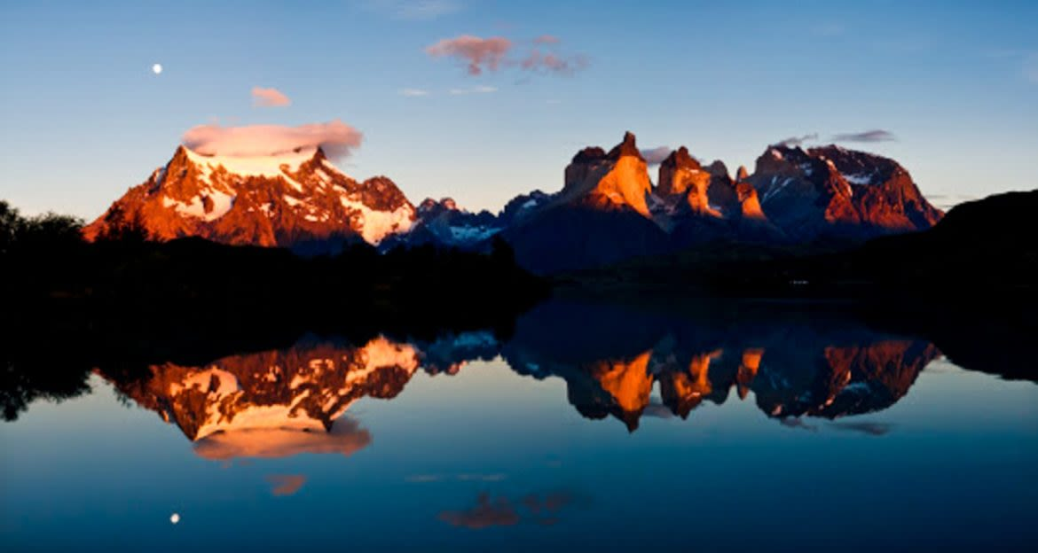 Sunset over Patagonia mountains and lake