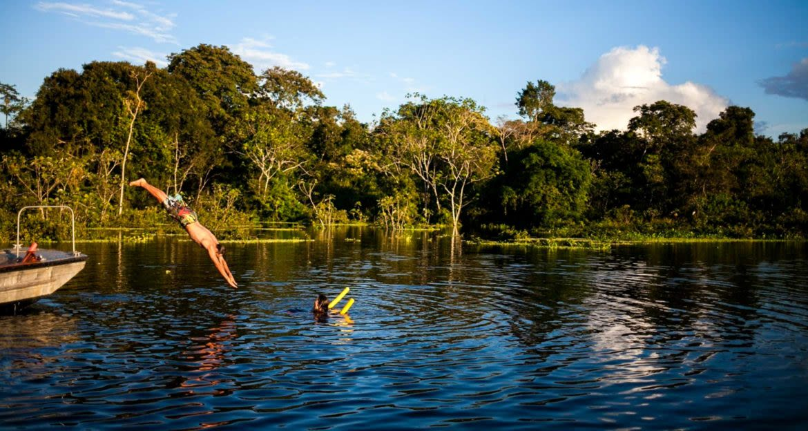 Traveler dives into Amazon river from cruise