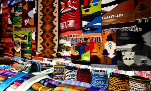 Tapestries hang in market