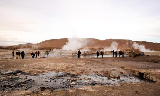 Tourists gather around Tatio Geysers