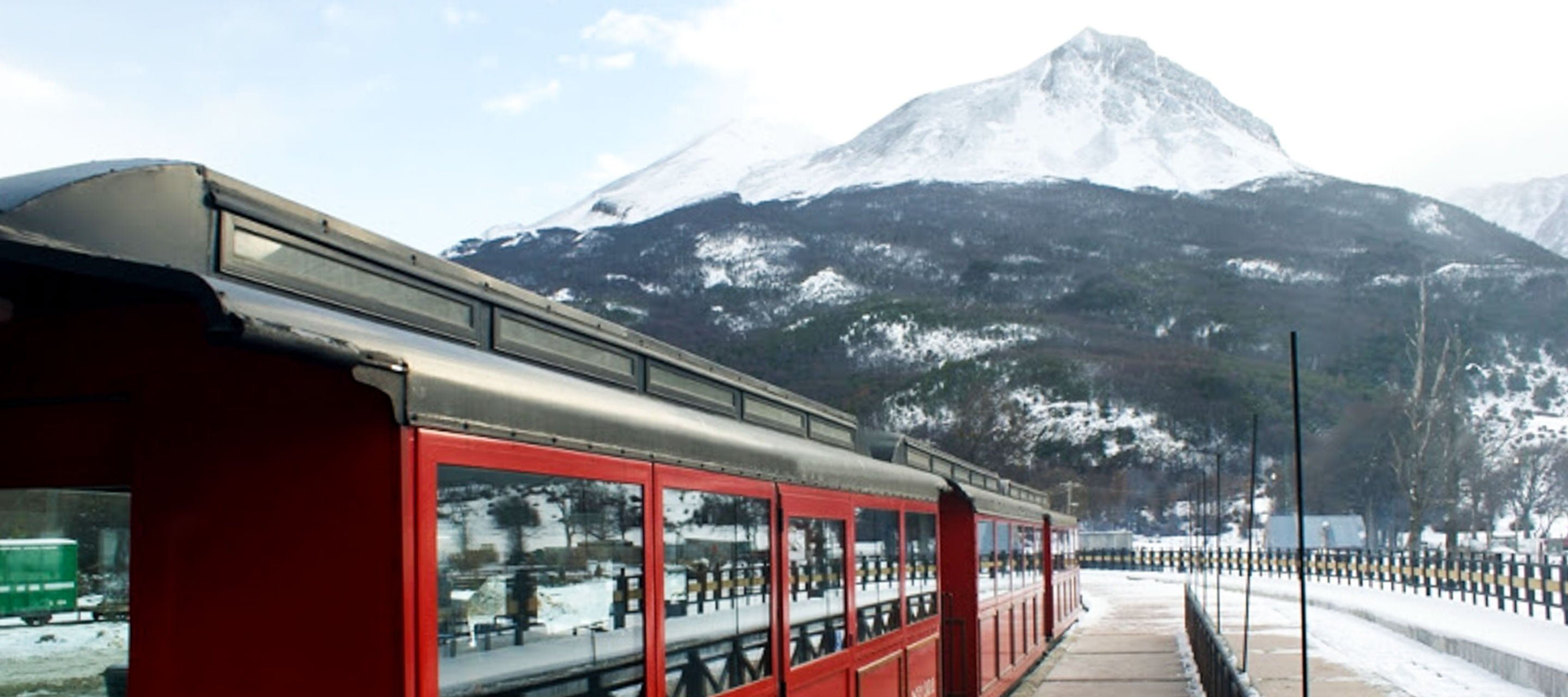 Train in front of Tierra del Fuego mountain