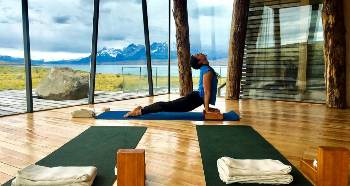 Person does yoga at Tierra Patagonia Hotel