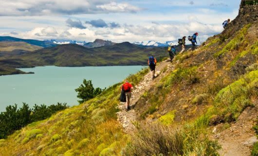 Hikers climb trail in Torres del Paine National Park