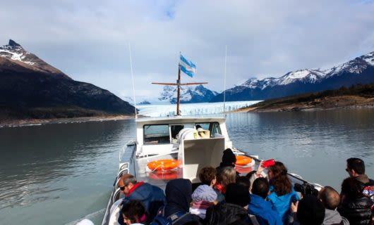 Tour group on small boat approaches Chile fjord