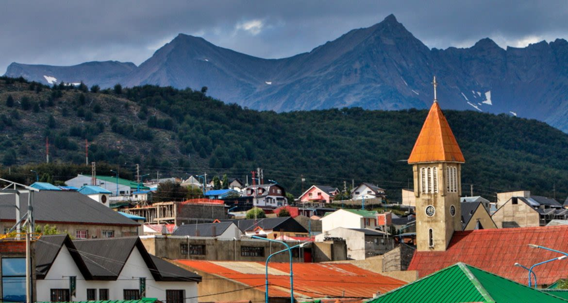 Roofs of town in front of mountains