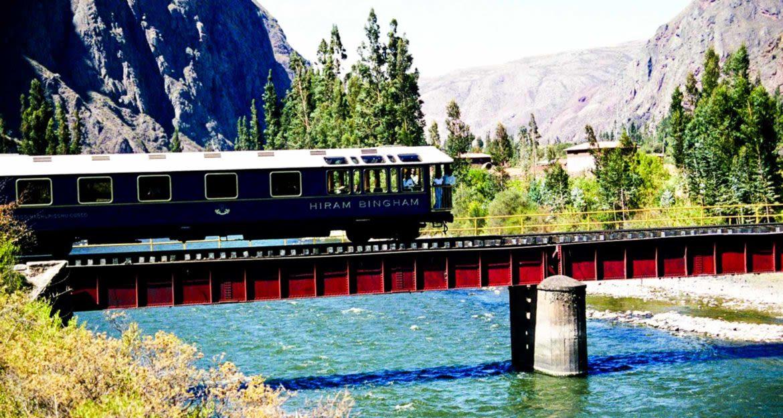 Train crosses small bridge over river