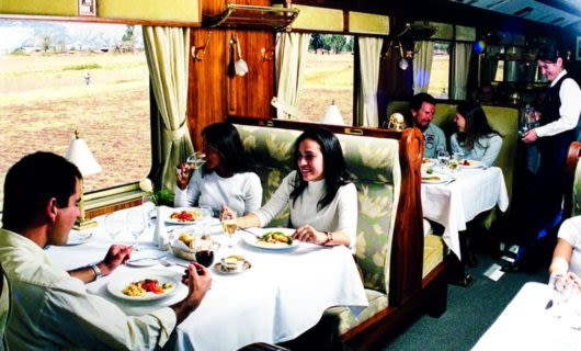 Travelers eat a meal in train dining car