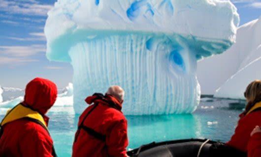 Travelers look at glacier pillar