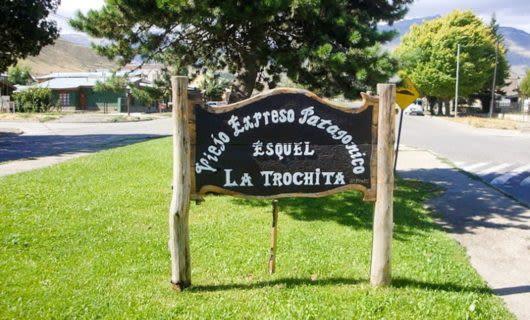 La Trochita sign in median of South America road
