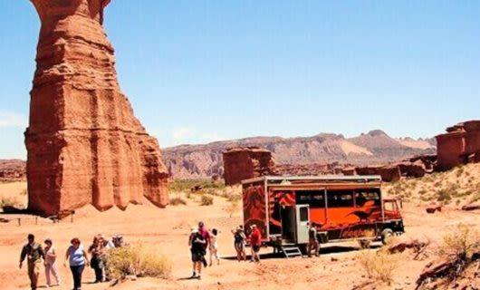 Red truck parked in desert