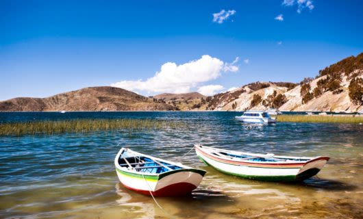 Two boats anchored near shore