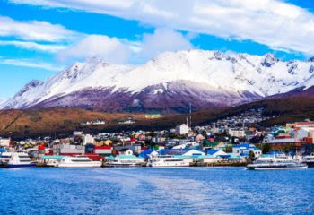 Snowcapped mountains and harbor of Ushuaia, a town in southern Argentina