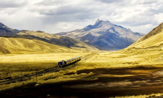 Train traveling through empty valley