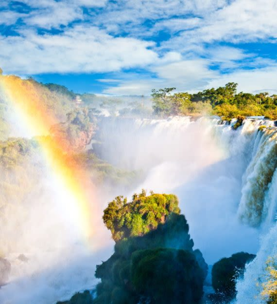 Rainbow over waterfall in South America