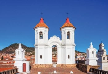 Two white bell towers seen in Sucre Bolivia on a tour of Bolivia
