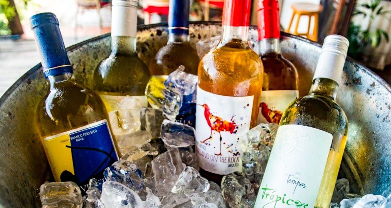 Wine bottles sit in ice bucket