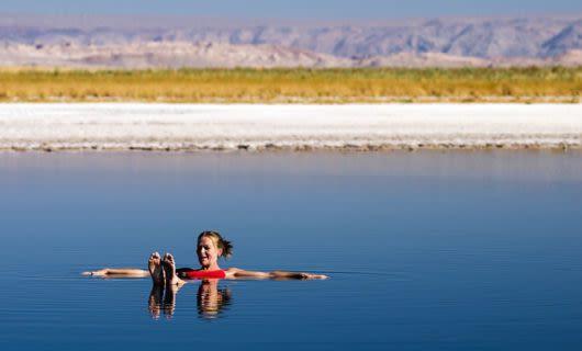 Woman floating on her back in desert springs