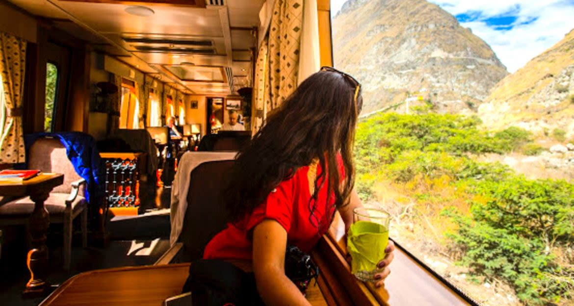 Woman leans into train window to see the view