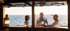 three people on the ecuador galapagos legend cruise